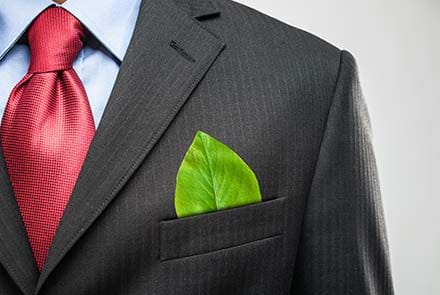 A vibrant green leaf in a suit pocket